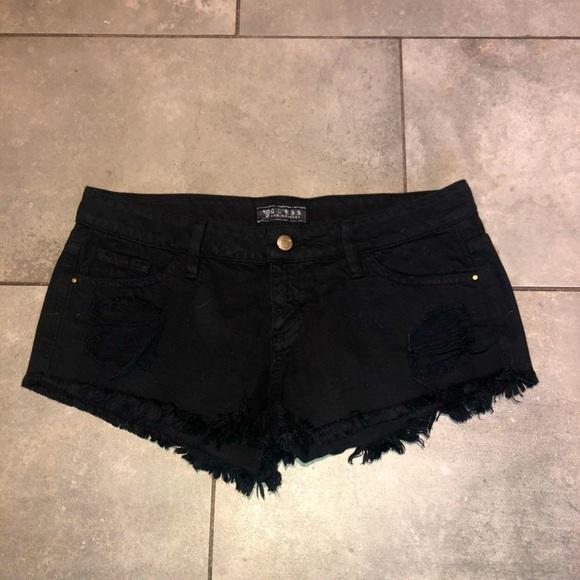 Black guess ripped Jean shorts